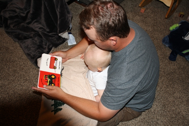 Daddy reading to Hank